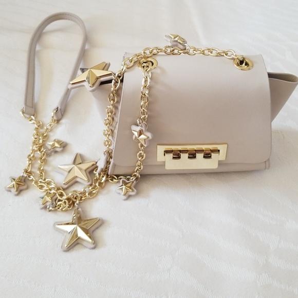 62faec25 ... Star Leather Mini Crossbody Bag. M_5b3e73802e1478b609319428